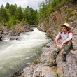Hiker and mountain river — Stock Photo