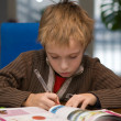 Boy writing homework — Stok fotoğraf
