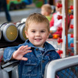Cute toddler boy on a merry-go-round — Stock Photo #1804122