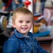 Cute toddler boy on a merry-go-round - Stock Photo