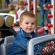 Royalty-Free Stock Photo: Cute toddler boy on a merry-go-round