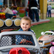 Cute toddler boy on a merry-go-round — Stock Photo
