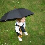 Teenage girl with black umbrella — Stock Photo #1804803