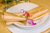 Napkin and orchid flower — Stock Photo