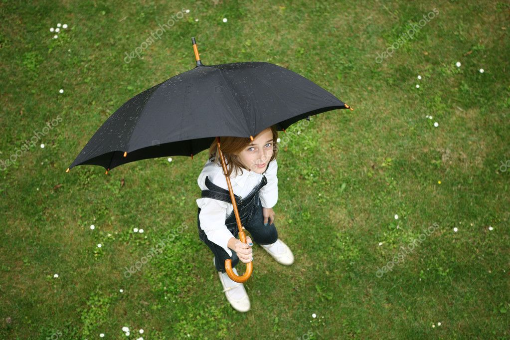 Teenage girl with black umbrella  Stock Photo #1804803