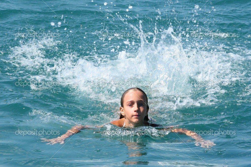 Girl swimming in blue sea and making splash  Stock Photo #2239182