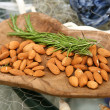 Almonds and rosemary — Stock Photo