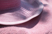 Sun hat on towel — Stock Photo