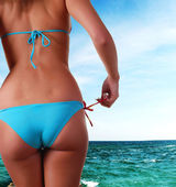 Female body in swimwear and sea — Stock Photo