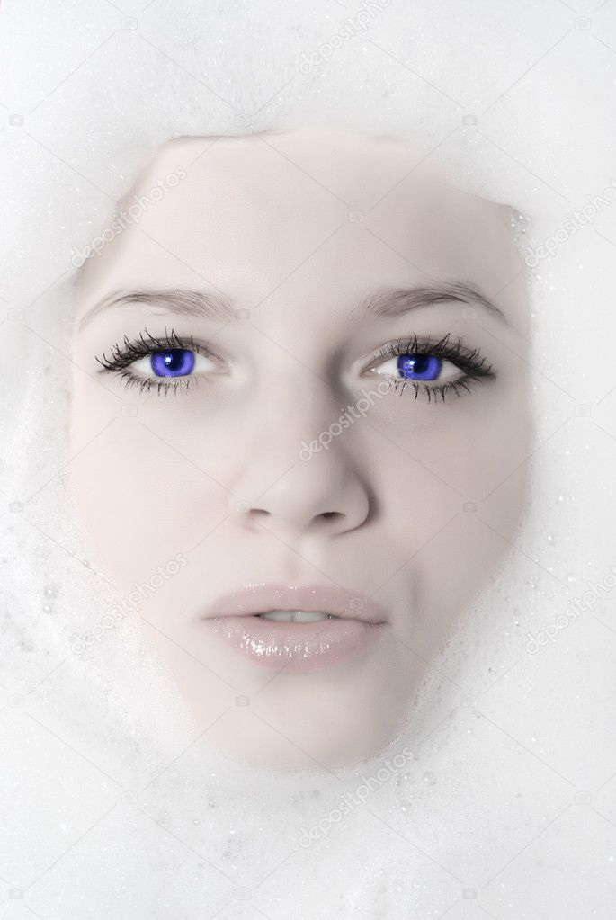 Face of a beautiful woman in white foam — Stock Photo #1755123