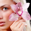 Royalty-Free Stock Photo: Face of woman and orchid