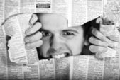 Throw newspaper black — Stock Photo