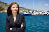 Woman and moorage with boats — Stock Photo