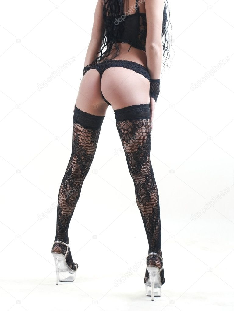 Beauty legs of young woman in stockings at white background — Stock Photo #1762778