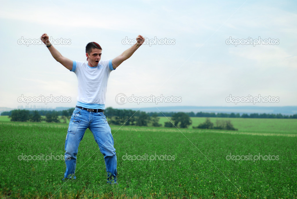 Happy young man have a good time on the green grass — Stock Photo #1763027