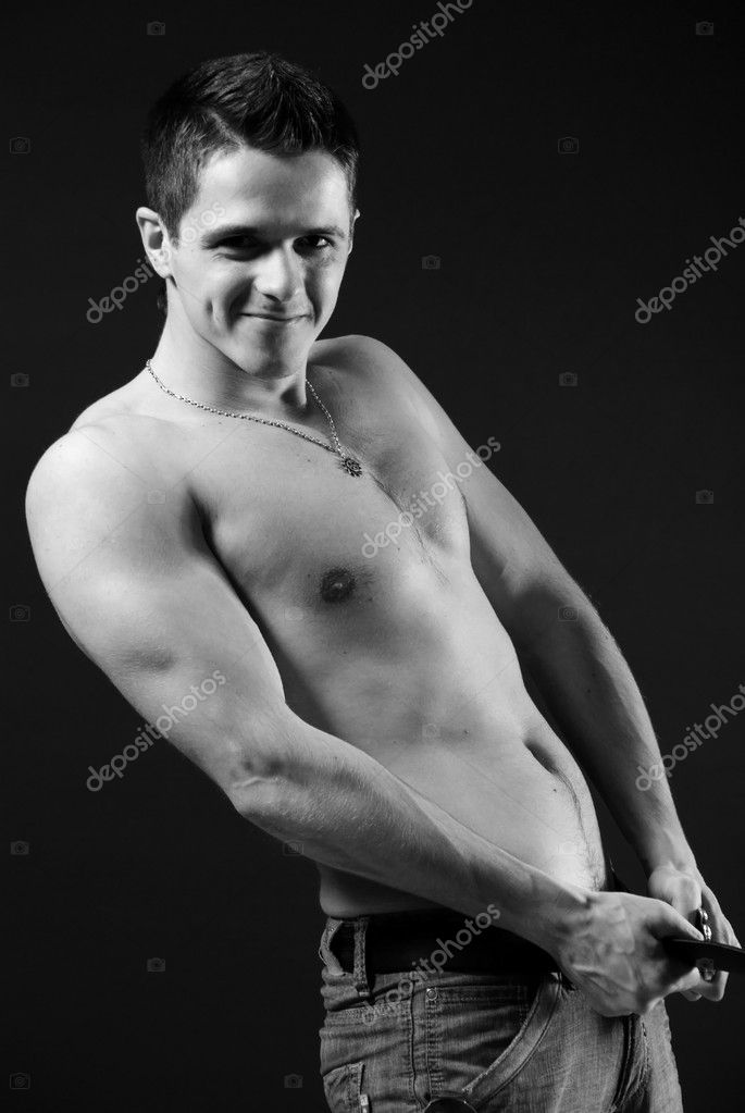 Naked muscular young man at black background  Stock Photo #1764304