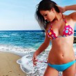 Woman in swimwear and beach — Stock Photo