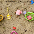 Toys in a sandbox - Stock Photo