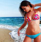 Woman in swimwear and beach — Stock Photo