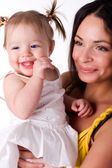 Little girl with beautiful mother — Stockfoto