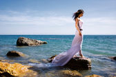 Woman and sea beach — Stockfoto