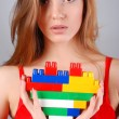 Woman with toy heart — Stockfoto
