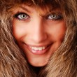 Woman in fur cap - Stock Photo