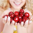 Cherry in hands — Stock Photo