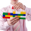 Man with toy bricks — Stock Photo