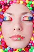 Beauty girl in candys — Stock Photo