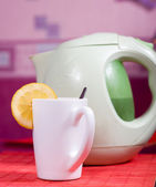 Cup and kettle — Stock Photo