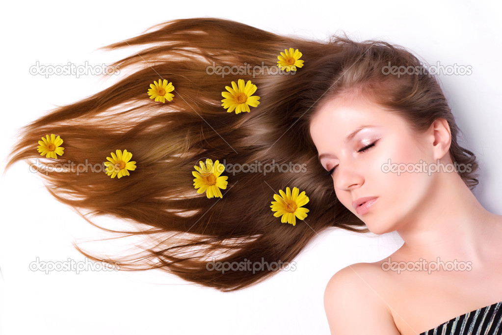 Young beautiful woman with yellow flowers in hair  — Stock Photo #2116039