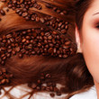 Royalty-Free Stock Photo: Woman\'s face with coffee  beans
