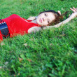 Young woman and green grass — Stock Photo