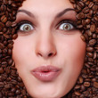 Woman's face with coffee beans — Stock Photo #2343214