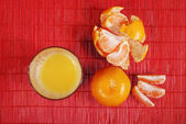 Glass of juice and tangerine — Stock Photo
