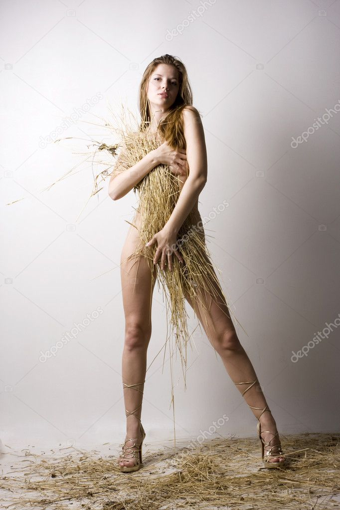 Young beautiful naked woman with straw wisp — Stock Photo #2343725