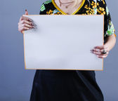 Woman takes placard — Foto Stock