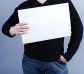 Man takes placard — Stock Photo