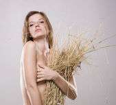 Naked woman and straw wisp — Stock Photo