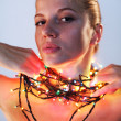 Stock Photo: Womwith garland