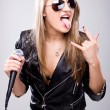 Young singer with microphone — Stock Photo
