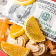 Stock Photo: Paper money and sweets