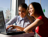Two women with laptop — Stock Photo