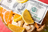 Paper money and sweets — Stock Photo