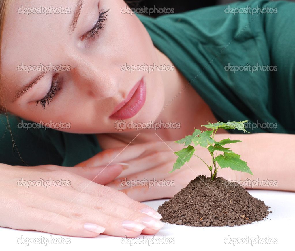 Beautiful young woman with green sprout of tree  — Stock Photo #2498481