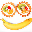 Smiling cake and banana — Stock Photo
