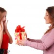 Two women with box — Stock Photo
