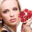 Woman and pomegranate — Stock Photo