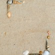 Shells on sand frame — Stock Photo